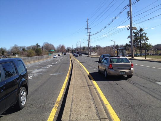 The narrow median on East Ridgewood Avenue that commuters