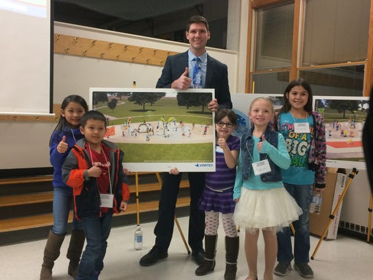 Students from Mead Elementary Charter school with Mayor