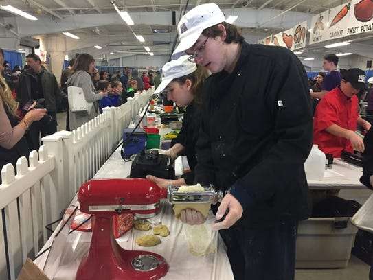 South Burlington High School Student makes pasta at