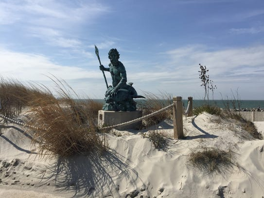 A sculpture of King Neptune sits on the Cape Charles