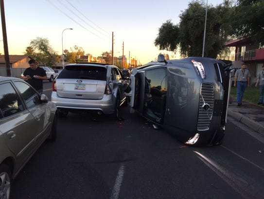 Scene from an accident in Tempe. The car on its side