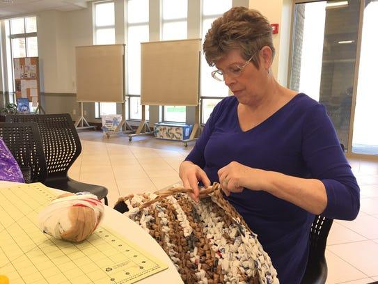 Caren Umans crochets plarn — plastic yarn — into a