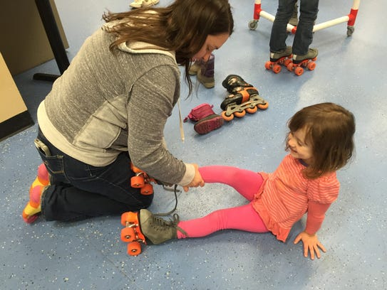 MaryKate Canavan of Colchester helps her 4-year-old
