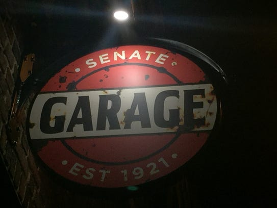 The vintage sign for the Senate Garage in Kingston