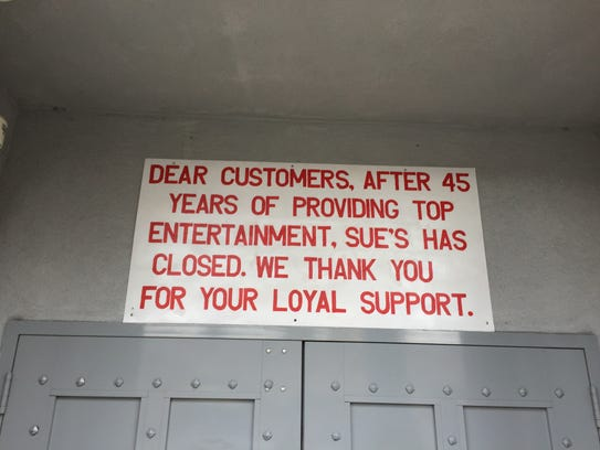 A sign posted above the entrance to Sue's Rendezvous