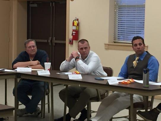Joshua Corney, right, listens during a Glen Rock council