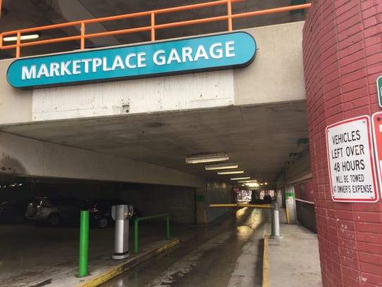 A sign on the Marketplace Garage entrance on Cherry