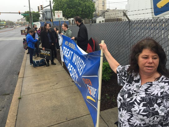 Worker advocates protest working conditions and wages