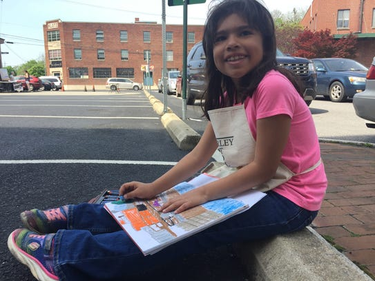 Brianna Aceituno, 7, of Waynesboro sits down in the