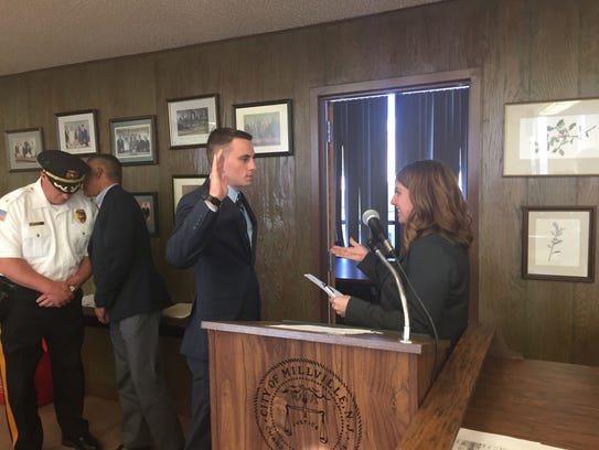 Glenn Miller takes the oath as a special police officer