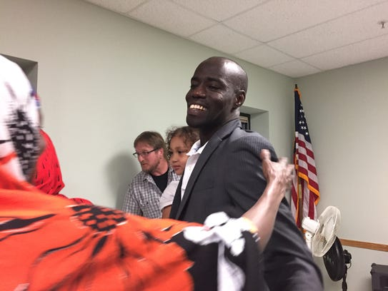 Supporters congratulate Ali Dieng after he wins the