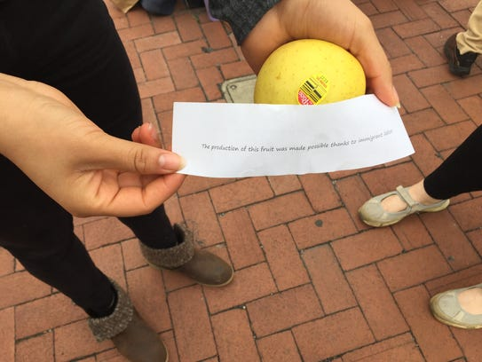 Two women handed out apples at the Gettysburg Rising