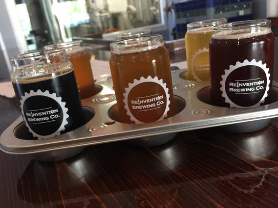 A colorful six-beer flight at Manchester's Reinvention