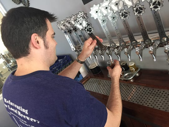 Owner/brewer George Aldrich pours a beer inside his