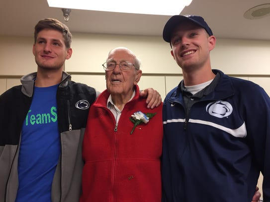 Harry L. Oyler, center, is flanked by grandsons Nathan