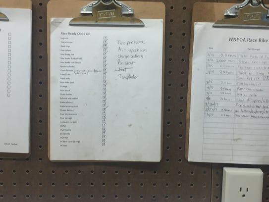 These checklists that hang in Devon Feehan's garage