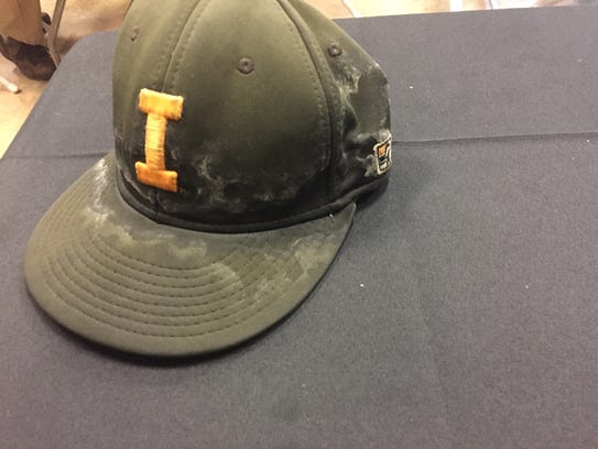Ryan Erickson's hat sits on a table at the Big Ten
