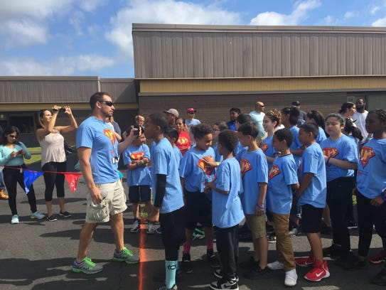 Physical education teacher Jim  Appleby herds fifth-graders