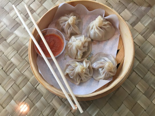 Bison momos with spicy tomato chutney at Dumpling Darling