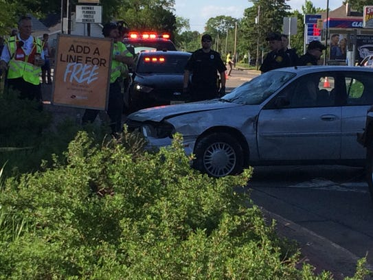 A car is pulled out of Boost Mobile in Stevens Point