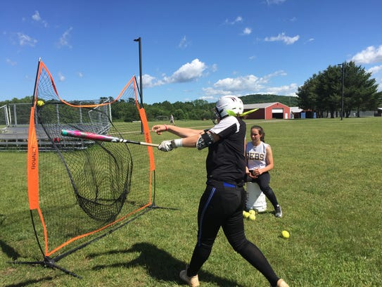 Pine Plains' Cat Simmons takes swings during practice.