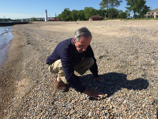 Dennis Kovach looks for beach glass and Petoskey stones