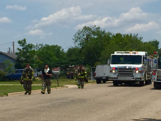 Emergency personnel respond to a structure fire at
