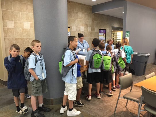 Third Grade Academy students line up for a hot breakfast