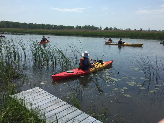 Kayakers launch from behind the Harsens Island Schoolhouse