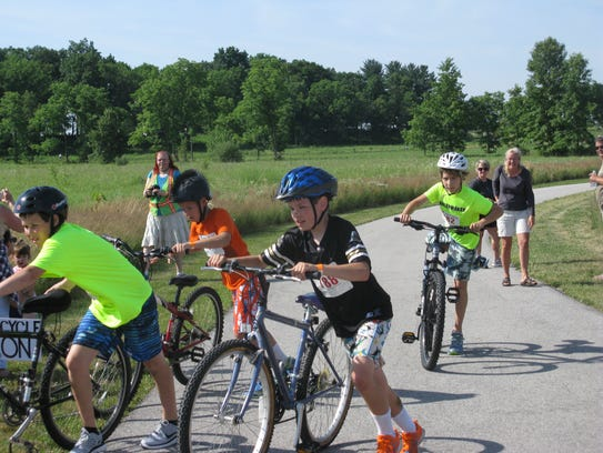Children begin the cycling portion of the Chasing Clouds