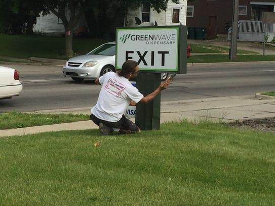 An employee at the Greenwave medical marijuana dispensary