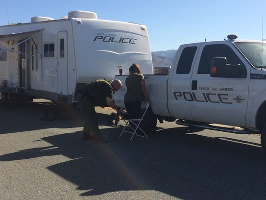 Desert Hot Springs police inspect a woman who was taken