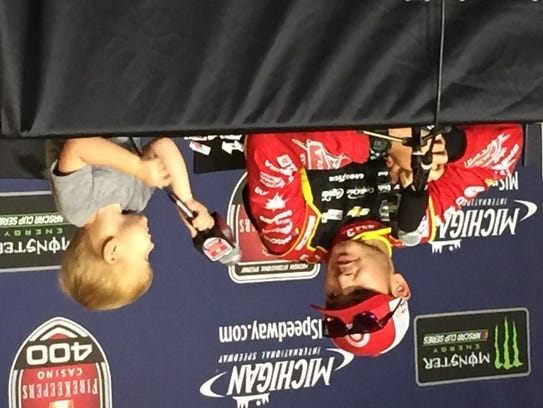 Kyle Larson is joined by son Owen after taking the