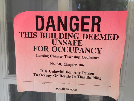 As of June 16, this sign was still posted on the door