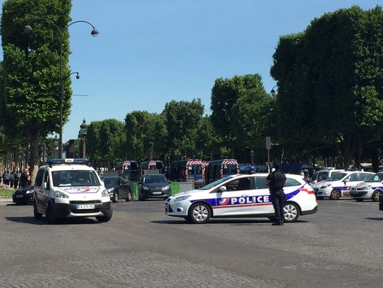 Police vehicles prevent the access to the Champs Elysees