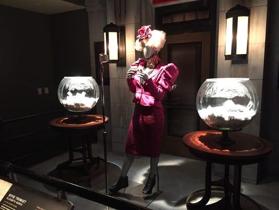 The costume worn by Effie Trinket (Elizabeth Banks)