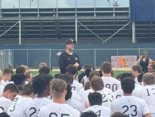 Michigan coach Jim Harbaugh speaks at the U-M elite