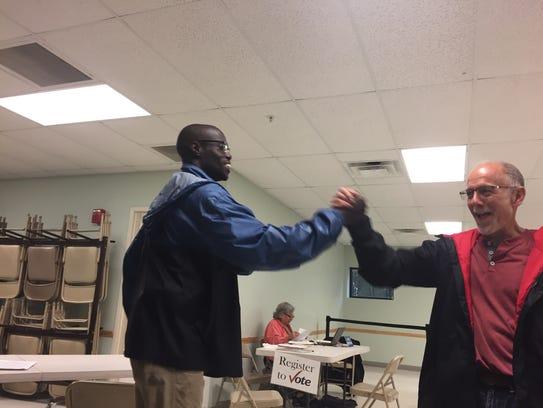 Dan Herman congratulates Ali Dieng after he wins the