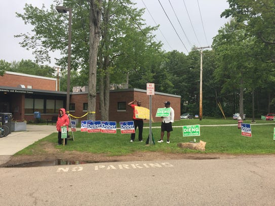 Candidates and campaigns wait for voters outside the