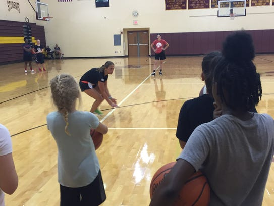 New Licking Heights coach Rebecca Bailey demonstrates