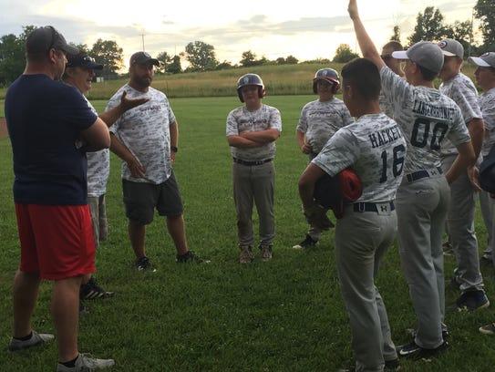 Kyle Langenbrunner (00) responds to assistant coach