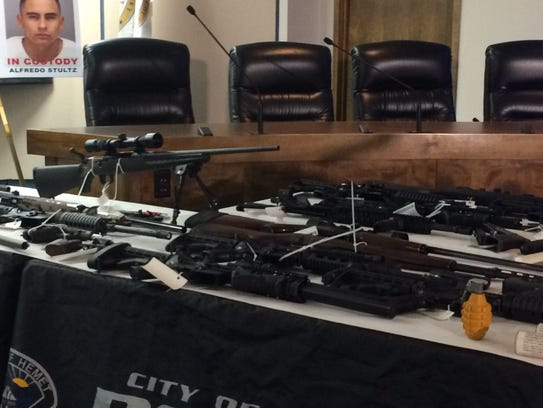 A scoped rifle and grenade were among weapons seized