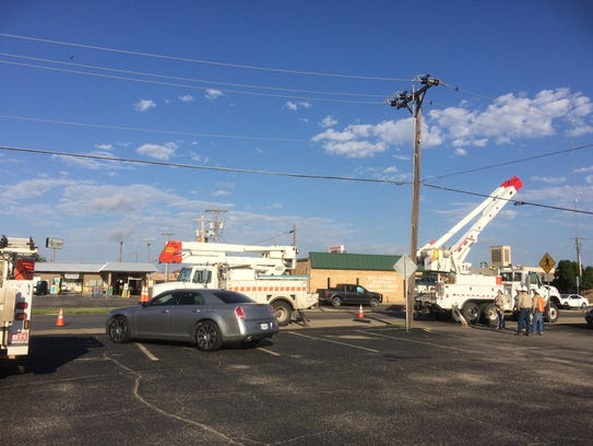 Several AEP trucks and crews are working near San Angelo's