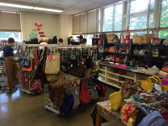The purse room at Saint's Place sale, Pittsford