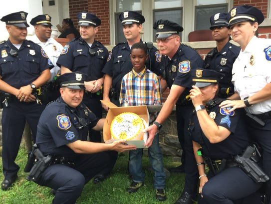 Wilmington police officers surprised 11-year-old Jarrell