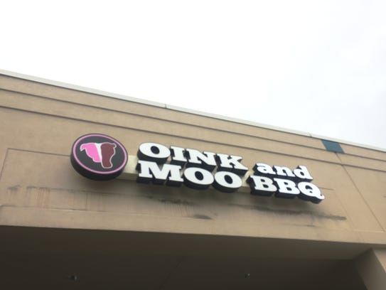 Oink and Moo BBQ is located in the Ritz Shopping Center
