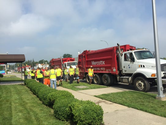 Marcotte employees stand outside Pollock-Randal Funeral