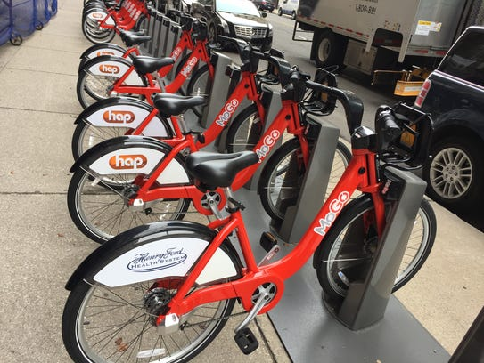 MoGo bikes docked at the station near Fort and Griswold