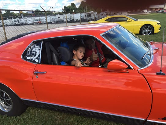 Nino, 7, is in the Ford Mustang before it was destroyed