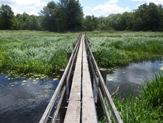 A bridge at Pike Run Wildlife Area in Nichols is shown